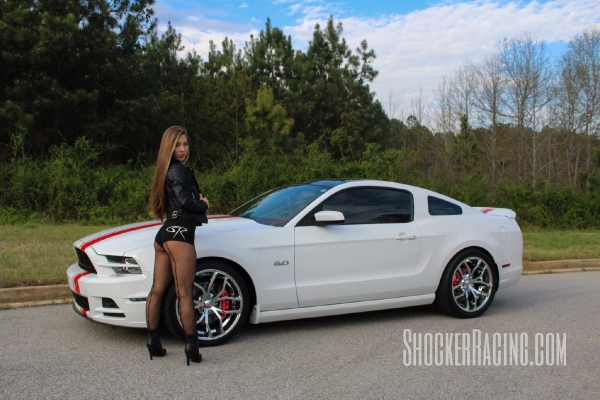 Taylor Ethridge with her 2014 Mustang 5.0